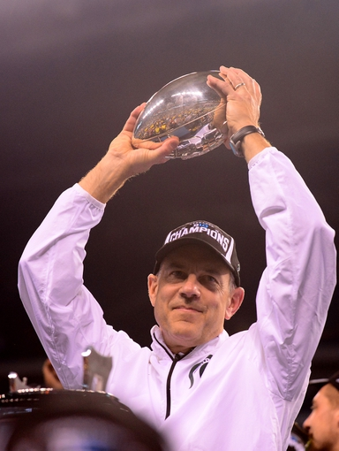 Dec 7, 2013; Indianapolis, IN, USA; Michigan State Spartans head coach Mark Dantonio holds the championship trophy after defeating Ohio State Buckeyes 34-24 to win the 2013 Big 10 Championship game at Lucas Oil Stadium. Mandatory Credit: Andrew Weber-USA TODAY Sports