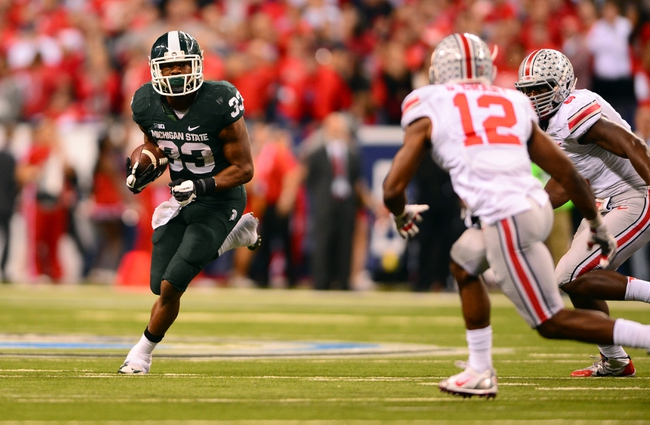 Dec 7, 2013; Indianapolis, IN, USA; Michigan State Spartans running back Jeremy Langford (33) runs the ball during the fourth quarter of the 2013 Big 10 Championship game against the Ohio State Buckeyes at Lucas Oil Stadium. Michigan State Spartans defeated Ohio State Buckeyes 34-24. Mandatory Credit: Andrew Weber-USA TODAY Sports