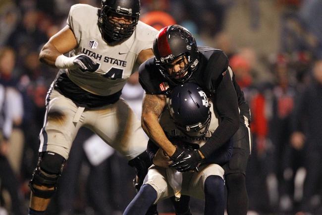 Dec 7, 2013; Fresno, CA, USA; Utah State Aggies quarterback Darell Garretson (6) is sacked by Fresno State Bulldogs linebacker Donavon Lewis (27) in the third quarter at Bulldog Stadium. The Bulldogs defeated the Aggies 24-17. Mandatory Credit: Cary Edmondson-USA TODAY Sports