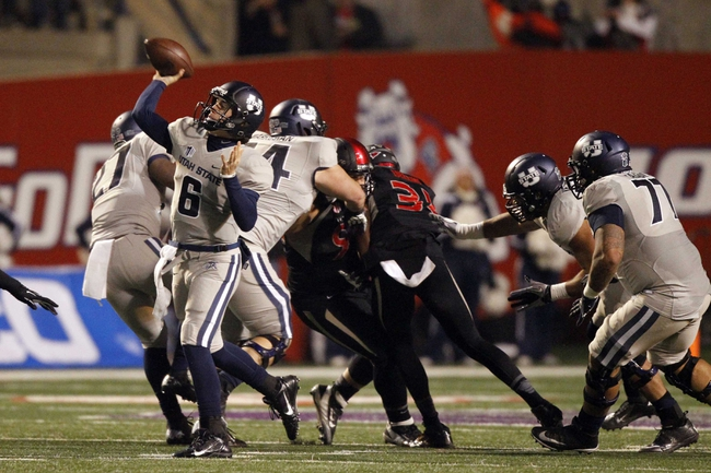 Dec 7, 2013; Fresno, CA, USA; Utah State Aggies quarterback Darell Garretson (6) throws a pass against the Fresno State Bulldogs in the third quarter at Bulldog Stadium. The Bulldogs defeated the Aggies 24-17. Mandatory Credit: Cary Edmondson-USA TODAY Sports