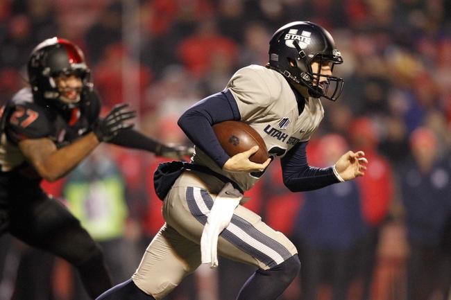 Dec 7, 2013; Fresno, CA, USA; Utah State Aggies quarterback Darell Garretson (6) runs the ball against the Fresno State Bulldogs in the third quarter at Bulldog Stadium. The Bulldogs defeated the Aggies 24-17. Mandatory Credit: Cary Edmondson-USA TODAY Sports