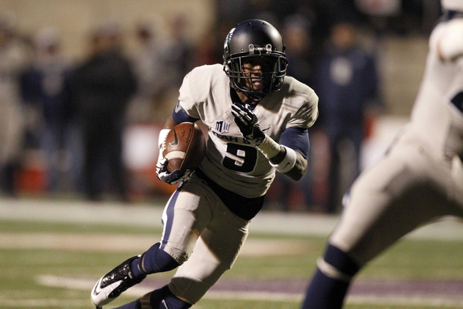 Dec 7, 2013; Fresno, CA, USA; Utah State Aggies wide receiver Bruce Natson (9) runs for a touchdown against the Fresno State Bulldogs in the fourth quarter at Bulldog Stadium. The Bulldogs defeated the Aggies 24-17. Mandatory Credit: Cary Edmondson-USA TODAY Sports