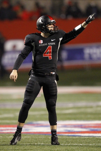 Dec 7, 2013; Fresno, CA, USA; Fresno State Bulldogs quarterback Derek Carr (4) points to the sideline between play against the Utah State Aggies in the fourth quarter at Bulldog Stadium. The Bulldogs defeated the Aggies 24-17. Mandatory Credit: Cary Edmondson-USA TODAY Sports