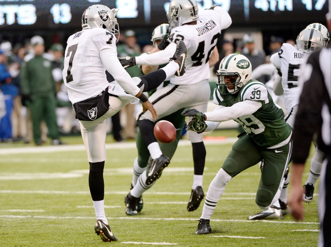Dec 8, 2013; East Rutherford, NJ, USA; New York Jets free safety Antonio Allen (39) blocks a punt by Oakland Raiders punter Marquette King (7) and returns it for a touchdown in the first half during the game at MetLife Stadium. Mandatory Credit: Robert Deutsch-USA TODAY Sports