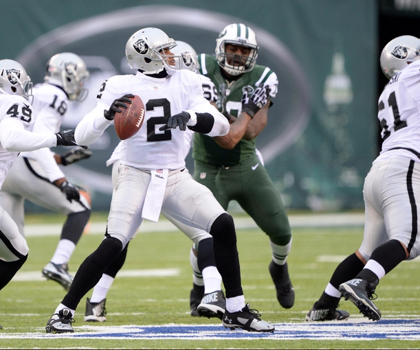 Dec 8, 2013; East Rutherford, NJ, USA; Oakland Raiders quarterback Terrelle Pryor (2) throws a pass against the New York Jets during the game at MetLife Stadium. Mandatory Credit: Robert Deutsch-USA TODAY Sports