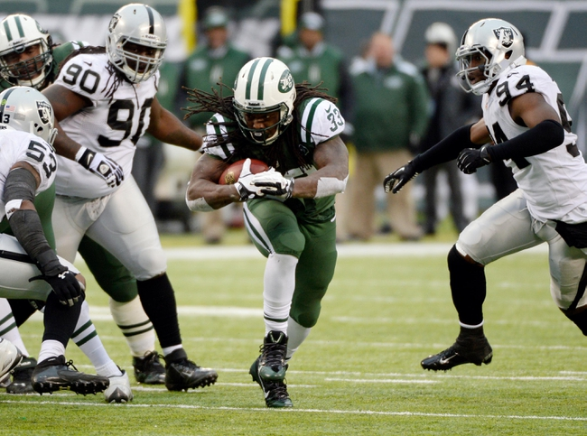 Dec 8, 2013; East Rutherford, NJ, USA; New York Jets running back Chris Ivory (33) in the second half against the Oakland Raiders during the game at MetLife Stadium. Mandatory Credit: Robert Deutsch-USA TODAY Sports
