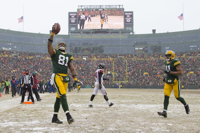 Dec 8, 2013; Green Bay, WI, USA; Green Bay Packers tight end Andrew Quarless (81) celebrates a touchdown catch during the fourth quarter against the Atlanta Falcons at Lambeau Field.  Green Bay won 22-21.  Mandatory Credit: Jeff Hanisch-USA TODAY Sports