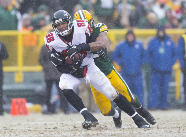 Dec 8, 2013; Green Bay, WI, USA; Atlanta Falcons tight end Tony Gonzalez (88) is tackled with the football during the fourth quarter against the Green Bay Packers at Lambeau Field.  Green Bay won 22-21.  Mandatory Credit: Jeff Hanisch-USA TODAY Sports