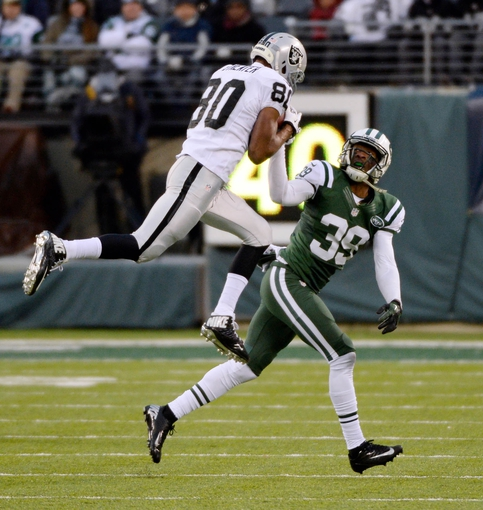 Dec 8, 2013; East Rutherford, NJ, USA; Oakland Raiders wide receiver Rod Streater (80) catches a pass against New York Jets free safety Antonio Allen (39) during the game at MetLife Stadium. Mandatory Credit: Robert Deutsch-USA TODAY Sports