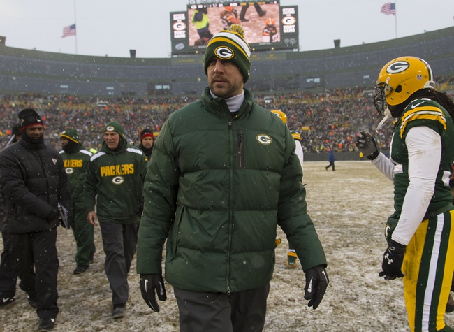 Dec 8, 2013; Green Bay, WI, USA; Green Bay Packers quarterback Aaron Rodgers walks off the field following the game against Atlanta Falcons at Lambeau Field.  Green Bay won 22-21.  Mandatory Credit: Jeff Hanisch-USA TODAY Sports