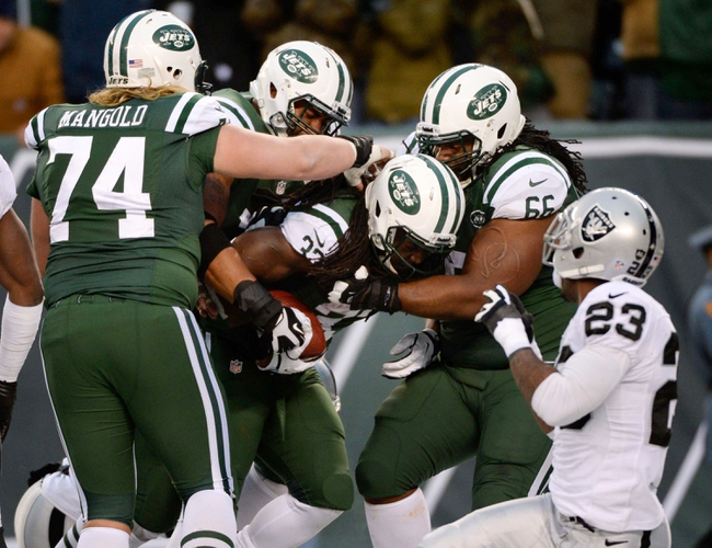 Dec 8, 2013; East Rutherford, NJ, USA; New York Jets running back Chris Ivory (33) is congratulated by teammates after scoring a touchdown in the fourth quarter against the Oakland Raiders during the game at MetLife Stadium. Mandatory Credit: Robert Deutsch-USA TODAY Sports