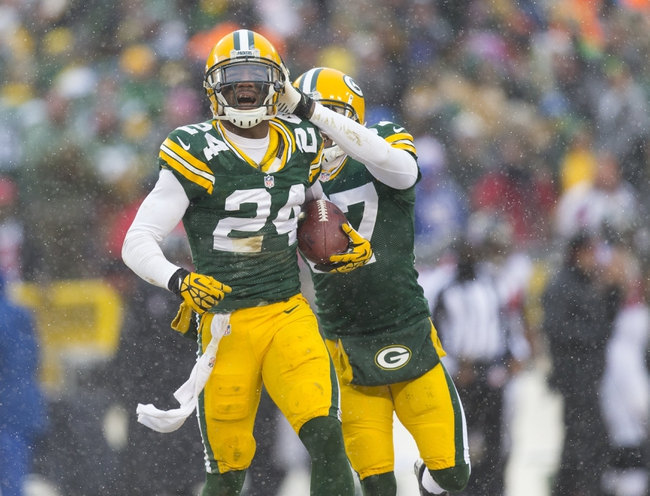 Dec 8, 2013; Green Bay, WI, USA; Green Bay Packers cornerback Jarrett Bush (24) celebrates an interception during the fourth quarter against the Atlanta Falcons at Lambeau Field.  Green Bay won 22-21.  Mandatory Credit: Jeff Hanisch-USA TODAY Sports