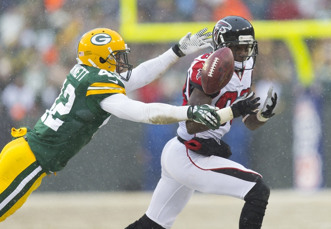 Dec 8, 2013; Green Bay, WI, USA; Green Bay Packers safety Morgan Burnett (42) breaks up the pass intended for Atlanta Falcons wide receiver Harry Douglas (83) during the fourth quarter at Lambeau Field.  Green Bay won 22-21.  Mandatory Credit: Jeff Hanisch-USA TODAY Sports