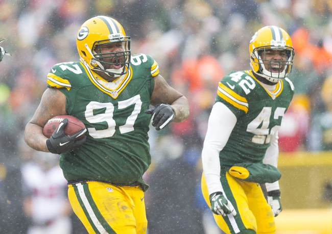 Dec 8, 2013; Green Bay, WI, USA; Green Bay Packers defensive tackle Johnny Jolly (97) celebrates after recovering a fumble during the fourth quarter against the Atlanta Falcons at Lambeau Field. Mandatory Credit: Jeff Hanisch-USA TODAY Sports