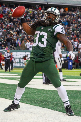 Dec 8, 2013; East Rutherford, NJ, USA; New York Jets running back Chris Ivory (33) celebrates his touchdown run during the second half of their game against the Oakland Raiders at MetLife Stadium. The Jets defeated the Raiders 37-27.  Mandatory Credit: Ed Mulholland-USA TODAY Sports