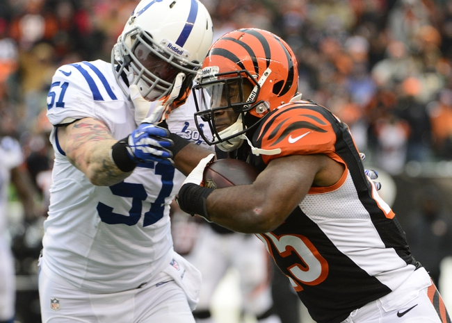 Dec 8, 2013; Cincinnati, OH, USA; Cincinnati Bengals running back Gio Bernard (25) attempts to prevent being tackled by Indianapolis Colts inside linebacker Pat Angerer (51) after receiving a pass during the second half of the game at Paul Brown Stadium. Cincinnati Bengals beat Indianapolis Colts 42-28 Mandatory Credit: Marc Lebryk-USA TODAY Sports