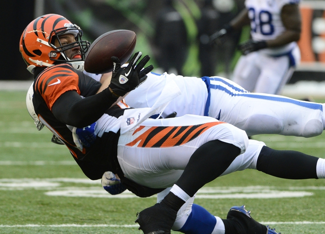 Dec 8, 2013; Cincinnati, OH, USA; Cincinnati Bengals wide receiver Marvin Jones (82) misses a pass while being defended by Indianapolis Colts linebacker Andy Studebaker (58) during the second half of the game at Paul Brown Stadium. Cincinnati Bengals beat Indianapolis Colts 42-28 Mandatory Credit: Marc Lebryk-USA TODAY Sports