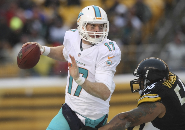 Dec 8, 2013; Pittsburgh, PA, USA; Miami Dolphins quarterback Ryan Tannehill (17) is sacked by Pittsburgh Steelers linebacker LaMarr Woodley (56) during the second half at Heinz Field. The Dolphins won the game, 34-27. Mandatory Credit: Jason Bridge-USA TODAY Sports