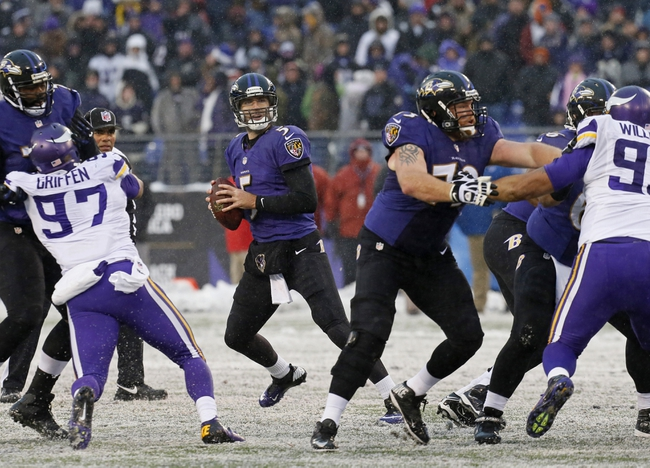 Dec 8, 2013; Baltimore, MD, USA; Baltimore Ravens quarterback Joe Flacco (5) looks to pass against the Minnesota Vikings at M&T Bank Stadium. Mandatory Credit: Mitch Stringer-USA TODAY Sports