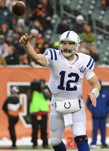 Dec 8, 2013; Cincinnati, OH, USA; Indianapolis Colts quarterback Andrew Luck (12) throws the ball during the second half of the game at Paul Brown Stadium. Cincinnati Bengals beat Indianapolis Colts 42-28 Mandatory Credit: Marc Lebryk-USA TODAY Sports