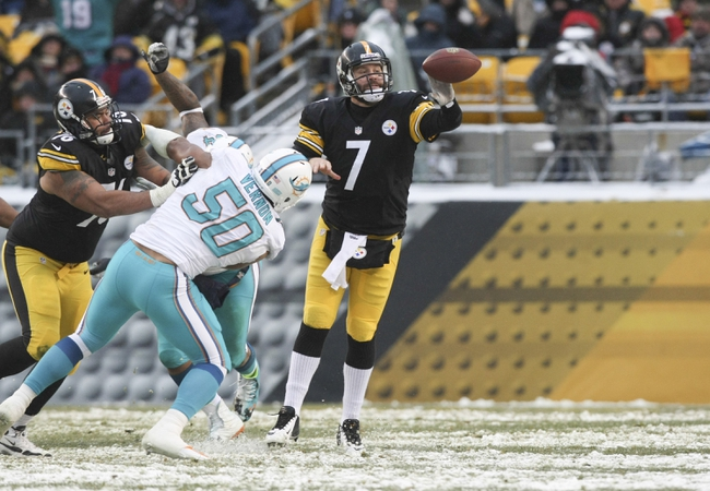 Dec 8, 2013; Pittsburgh, PA, USA; Pittsburgh Steelers quarterback Ben Roethlisberger (7) throws a pass under pressure from Miami Dolphins defensive end Olivier Vernon (50) during the second half at Heinz Field. The Dolphins won the game, 34-28. Mandatory Credit: Jason Bridge-USA TODAY Sports