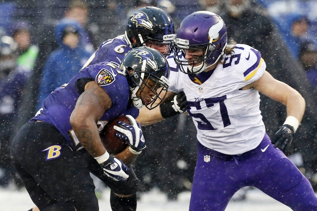 Dec 8, 2013; Baltimore, MD, USA; Baltimore Ravens running back Ray Rice (27) is tackled by Minnesota Vikings linebacker Audie Cole (57) at M&T Bank Stadium. Mandatory Credit: Mitch Stringer-USA TODAY Sports