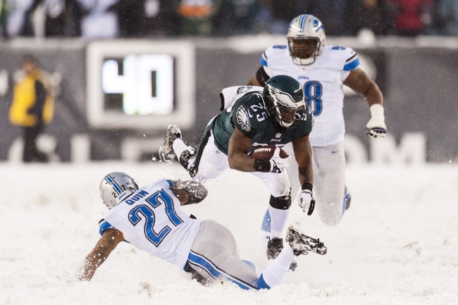 Dec 8, 2013; Philadelphia, PA, USA; Philadelphia Eagles running back LeSean McCoy (25) is tackled by Detroit Lions safety Glover Quin (27) during the fourth quarter at Lincoln Financial Field. The Eagles defeated the Lions 34-20. Mandatory Credit: Howard Smith-USA TODAY Sports