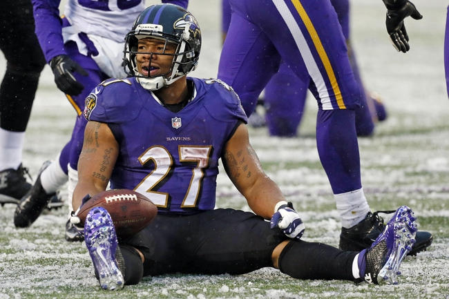 Dec 8, 2013; Baltimore, MD, USA; Baltimore Ravens running back Ray Rice (27) reacts after being tackled against the Minnesota Vikings at M&T Bank Stadium. Mandatory Credit: Mitch Stringer-USA TODAY Sports