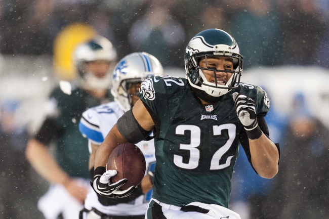 Dec 8, 2013; Philadelphia, PA, USA; Philadelphia Eagles running back Chris Polk (32) carries for a touchdown during the fourth quarter against the Detroit Lions at Lincoln Financial Field. The Eagles defeated the Lions 34-20. Mandatory Credit: Howard Smith-USA TODAY Sports