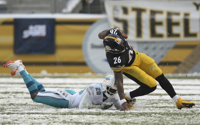 Dec 8, 2013; Pittsburgh, PA, USA; Pittsburgh Steelers running back Le'Veon Bell is tackled by Miami Dolphins safety Reshad Jones (20) during the second half at Heinz Field. The Dolphins won the game, 34-28. Mandatory Credit: Jason Bridge-USA TODAY Sports