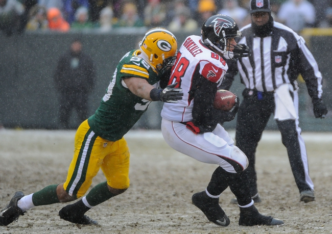 Dec 8, 2013; Green Bay, WI, USA;  Atlanta Falcons tight end Tony Gonzalez (88) is tackled by Green Bay Packers linebacker Brad Jones (59) after making a catch in the 4th quarter at Lambeau Field. Mandatory Credit: Benny Sieu-USA TODAY Sports