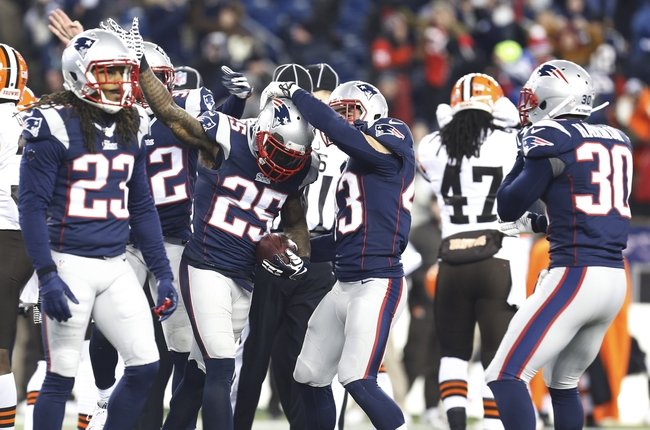 Dec 8, 2013; Foxborough, MA, USA; New England Patriots cornerback Kyle Arrington (25) celebrates after an onside kick against the Cleveland Browns in the second half at Gillette Stadium. The Patriots defeated the Cleveland Browns 27-26. Mandatory Credit: David Butler II-USA TODAY Sports