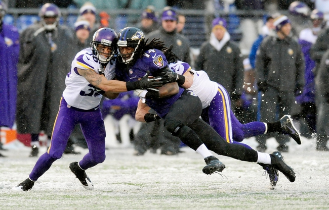 Dec 8, 2013; Baltimore, MD, USA; Baltimore Ravens wide receiver Marlon Brown (14) gets tackled by Minnesota Vikings safety Robert Blanton (36) at M&T Bank Stadium. Mandatory Credit: Evan Habeeb-USA TODAY Sports