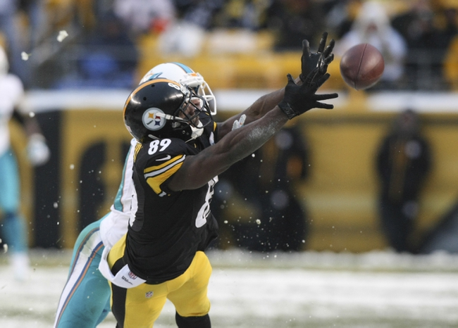 Dec 8, 2013; Pittsburgh, PA, USA; Pittsburgh Steelers wide receiver Jerricho Cotchery (89) just misses a pass under coverage from Miami Dolphins cornerback Brent Grimes (21) during the second half at Heinz Field. The Dolphins won the game, 34-28. Mandatory Credit: Jason Bridge-USA TODAY Sports