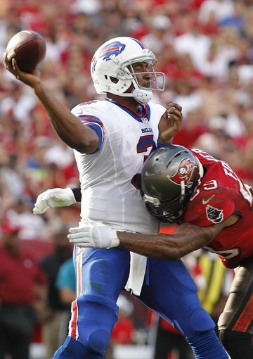 Dec 8, 2013; Tampa, FL, USA; Tampa Bay Buccaneers middle linebacker Mason Foster (59) pressures Buffalo Bills quarterback EJ Manuel (3) during the second half at Raymond James Stadium. Tampa Bay Buccaneers defeated the Buffalo Bills 27-6. Mandatory Credit: Kim Klement-USA TODAY Sports