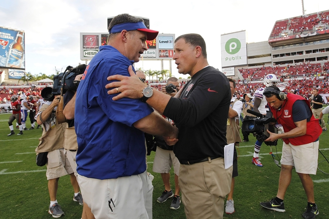 Dec 8, 2013; Tampa, FL, USA; Buffalo Bills head coach Doug Marrone and Tampa Bay Buccaneers head coach Greg Schiano greet at the end of the game at Raymond James Stadium. Tampa Bay Buccaneers defeated the Buffalo Bills 27-6. Mandatory Credit: Kim Klement-USA TODAY Sports