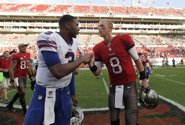 Dec 8, 2013; Tampa, FL, USA; Buffalo Bills quarterback EJ Manuel (3) and Tampa Bay Buccaneers quarterback Mike Glennon (8) greet at the end of tbe game at Raymond James Stadium. Tampa Bay Buccaneers defeated the Buffalo Bills 27-6. Mandatory Credit: Kim Klement-USA TODAY Sports