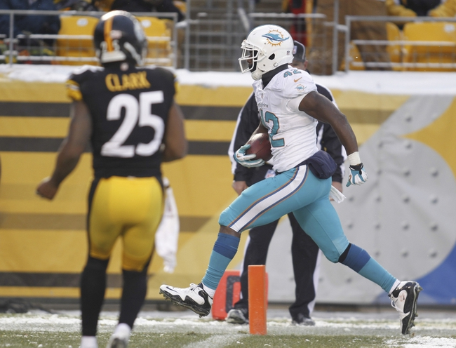 Dec 8, 2013; Pittsburgh, PA, USA; Miami Dolphins tight end Charles Clay (42) scores a twelve yard touchdown against the Pittsburgh Steelers during the fourth quarter at Heinz Field. The Miami Dolphins won 34-28. Mandatory Credit: Charles LeClaire-USA TODAY Sports