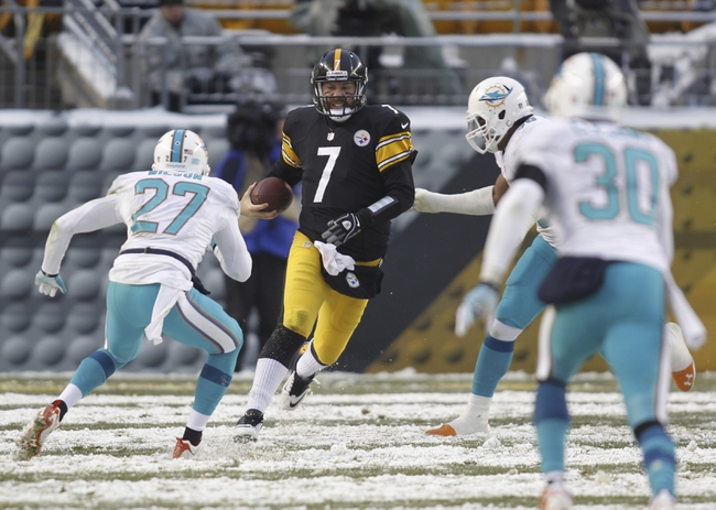 Dec 8, 2013; Pittsburgh, PA, USA; Pittsburgh Steelers quarterback Ben Roethlisberger (7) scrambles with the ball against the Miami Dolphins during the fourth quarter at Heinz Field. The Miami Dolphins won 34-28. Mandatory Credit: Charles LeClaire-USA TODAY Sports