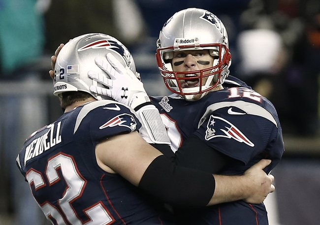 Dec 8, 2013; Foxborough, MA, USA; New England Patriots quarterback Tom Brady (12) celebrates with center Ryan Wendell (62) after he threw the winning touchdown pass during the fourth quarter of New England's 27-26 win over the Cleveland Browns at Gillette Stadium. Mandatory Credit: Winslow Townson-USA TODAY Sports