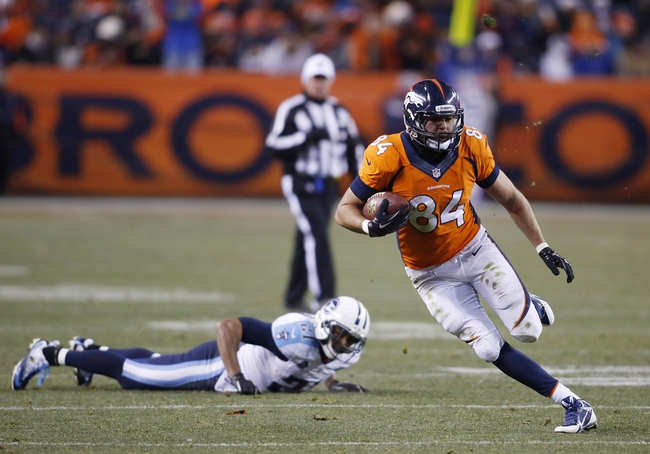 Dec 8, 2013; Denver, CO, USA; Denver Broncos tight end Jacob Tamme (84) runs with the ball after catching a pass during the second half against the Tennessee Titans at Sports Authority Field at Mile High. The Broncos won 51-28.  Mandatory Credit: Chris Humphreys-USA TODAY Sports