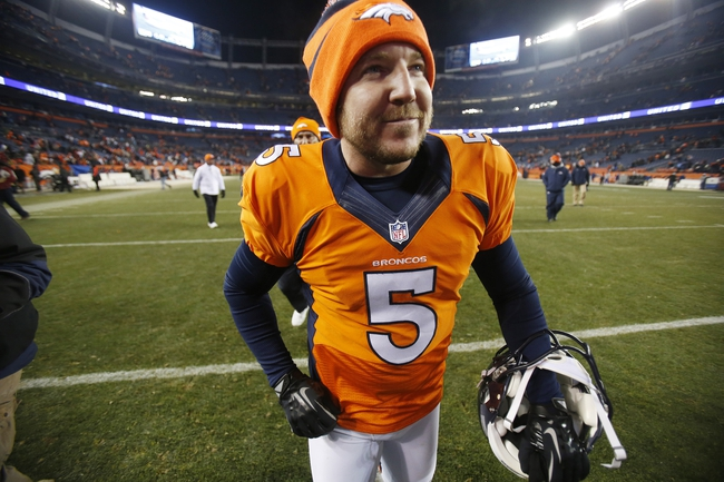 Dec 8, 2013; Denver, CO, USA; Denver Broncos kicker Matt Prater (5) walks off the field after the second half against the Tennessee Titans at Sports Authority Field at Mile High. The Broncos won 51-28.  Mandatory Credit: Chris Humphreys-USA TODAY Sports
