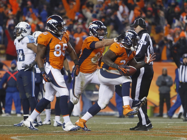 Dec 8, 2013; Denver, CO, USA; Denver Broncos running back Montee Ball (28) celebrates with teammates after scoring a touchdown during the second half against the Tennessee Titans at Sports Authority Field at Mile High. The Broncos won 51-28.  Mandatory Credit: Chris Humphreys-USA TODAY Sports