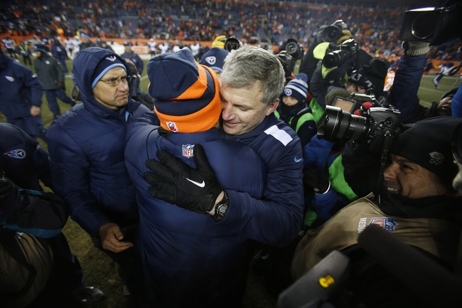 Dec 8, 2013; Denver, CO, USA; Denver Broncos head coach John Fox greets Tennessee Titans head coach Mike Munchak after the second half at Sports Authority Field at Mile High. The Broncos won 51-28.  Mandatory Credit: Chris Humphreys-USA TODAY Sports