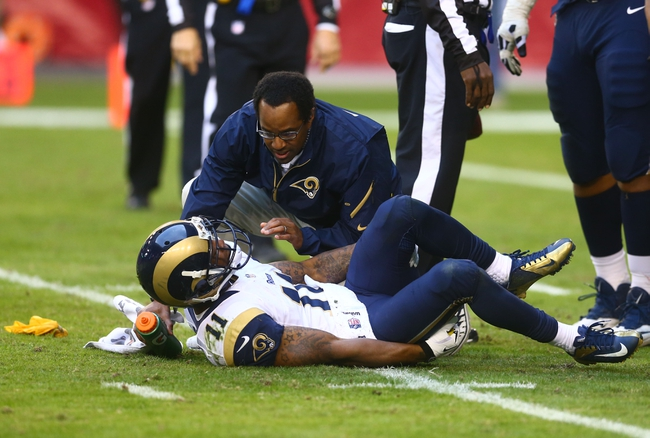 Dec 8, 2013; Phoenix, AZ, USA; St. Louis Rams wide receiver Tavon Austin (11) is tended to by a trainer after suffering an injury in the fourth quarter against the Arizona Cardinals at University of Phoenix Stadium. The Cardinals defeated the Rams 30-10. Mandatory Credit: Mark J. Rebilas-USA TODAY Sports