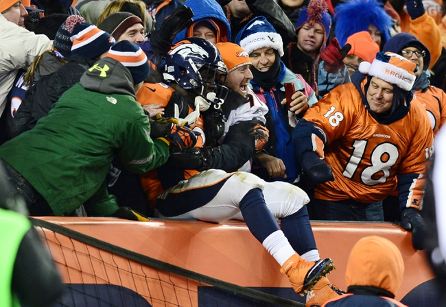 Dec 8, 2013; Denver, CO, USA; Denver Broncos running back Montee Ball (28) reacts with fans after running for a five yard touchdown in the fourth quarter against the Tennessee Titans at Sports Authority Field at Mile High. The Broncos defeated the Titans 51-28. Mandatory Credit: Ron Chenoy-USA TODAY Sports