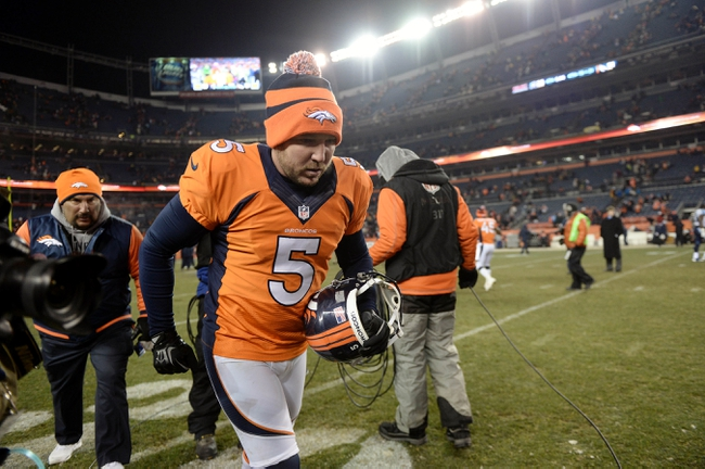 Dec 8, 2013; Denver, CO, USA; Denver Broncos kicker Matt Prater (5) leaves the field following the win over the Tennessee Titans at Sports Authority Field at Mile High. The Broncos defeated the Titans 51-28. Mandatory Credit: Ron Chenoy-USA TODAY Sports