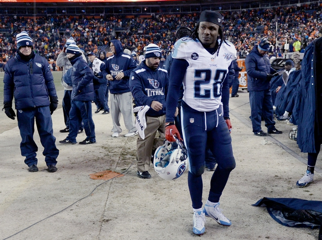 Dec 8, 2013; Denver, CO, USA; Tennessee Titans running back Chris Johnson (28) reacts on the sidelines late in the fourth quarter against the Denver Broncos at Sports Authority Field at Mile High. The Broncos defeated the Titans 51-28. Mandatory Credit: Ron Chenoy-USA TODAY Sports