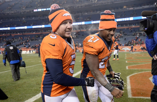 Dec 8, 2013; Denver, CO, USA; Denver Broncos kicker Matt Prater (5) and running back Knowshon Moreno (27) leave the field following the win over the Tennessee Titans at Sports Authority Field at Mile High. The Broncos defeated the Titans 51-28. Mandatory Credit: Ron Chenoy-USA TODAY Sports