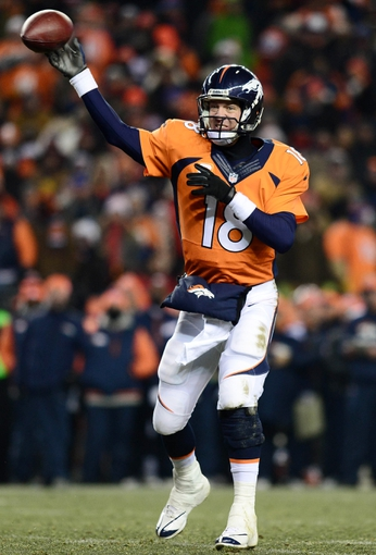 Dec 8, 2013; Denver, CO, USA; Denver Broncos quarterback Peyton Manning (18) passes in the fourth quarter against the Tennessee Titans at Sports Authority Field at Mile High. The Broncos defeated the Titans 51-28. Mandatory Credit: Ron Chenoy-USA TODAY Sports